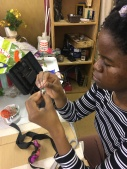 Shingi working on flower cowns